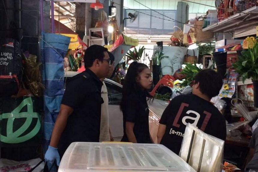 A white car crashed into a florist's stall at a market at Block 50A Marine Terrace.