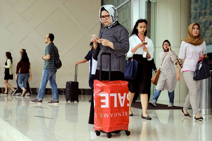 Women going shopping at Senayan City Mall in Jakarta, Indonesia, June 15, 2017.