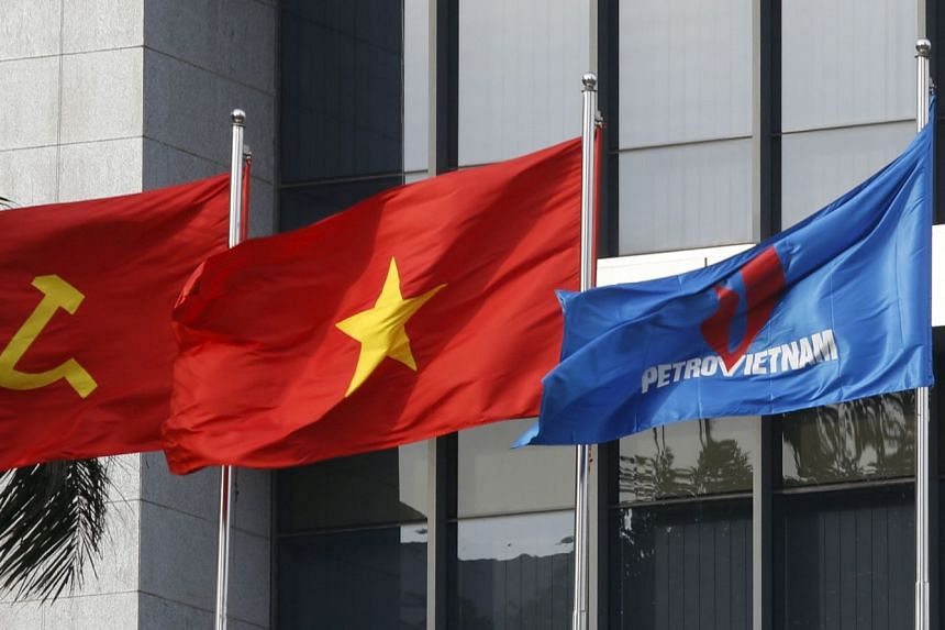 Flags flying outside PetroVietnam's headquarters in Hanoi in 2016.