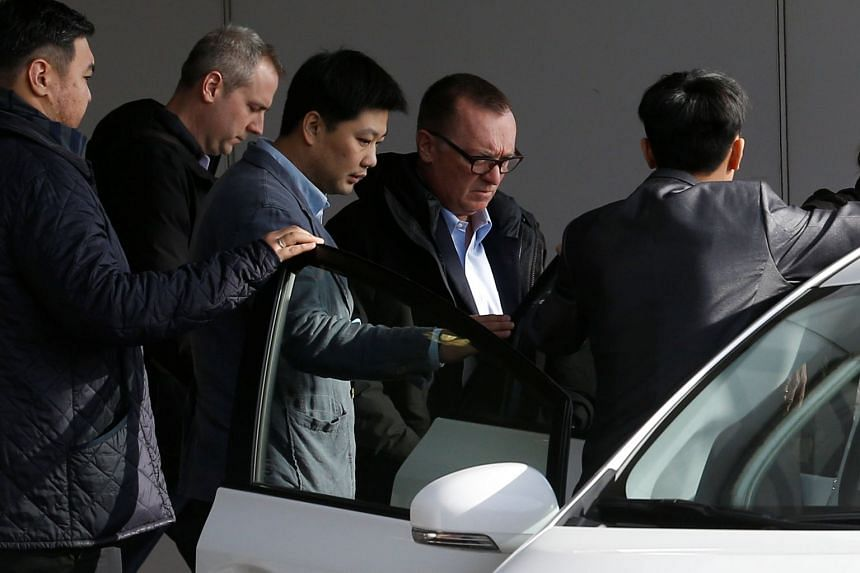 UN political affairs chief Jeffrey Feltman (second right) arrives at Beijing airport after his return from North Korea.