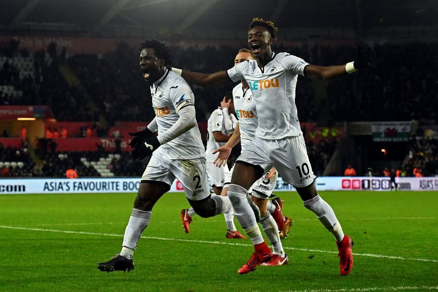 Swansea City's Wilfried Bony celebrates scoring their first goal with team mates.