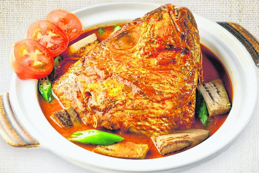 Today, fish head curry has an iconic status in Singapore and various versions of it have been created. Mr M.J. Gomez with his wife Mariyamma, daughter Philomena and son John in a photograph taken in Singapore before the family returned to India in th