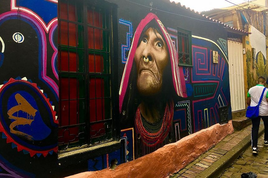 Bogota has become a world-renowned hot spot for street art by both local and international names, such as the murals (above) of Carlos Trilleras. Usaquen, a lively village in Bogota, is packed with bars and restaurants. A view of Bogota's vast, Andes