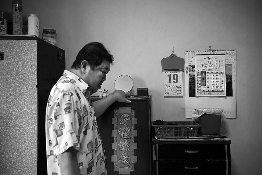 Mr Tay takes a moment in his room in his sister's Housing Board flat in Choa Chu Kang where he lived before moving to the Assisi Hospice. The wall calendar remains untouched, marking the day he left for the hospice - Sept 19. The visit on Oct 14 woul