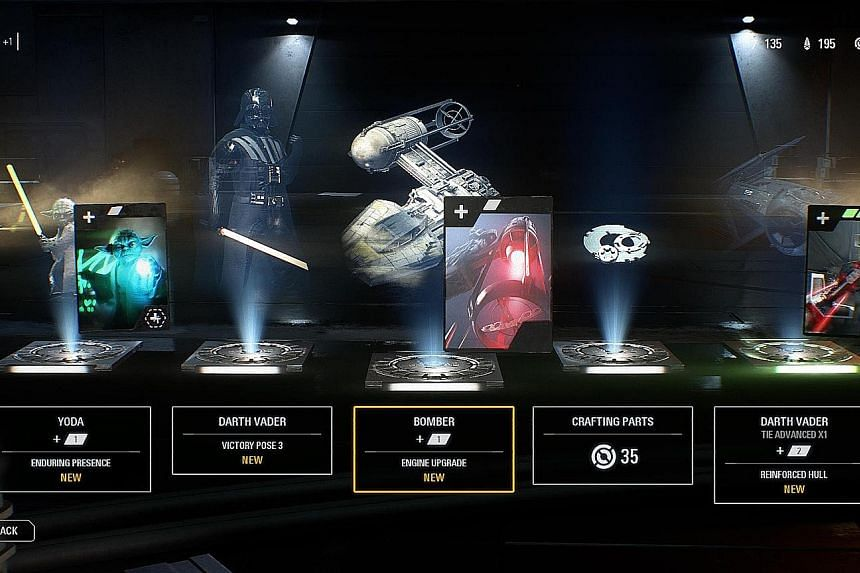 Items found in a US$1 (S$1.35) loot box from EA's Star Wars Battlefront II game with five items that range in game play value. For example, the Yoda item allows a player to access one of Yoda's abilities in-game, while the Darth Vader one is merely a