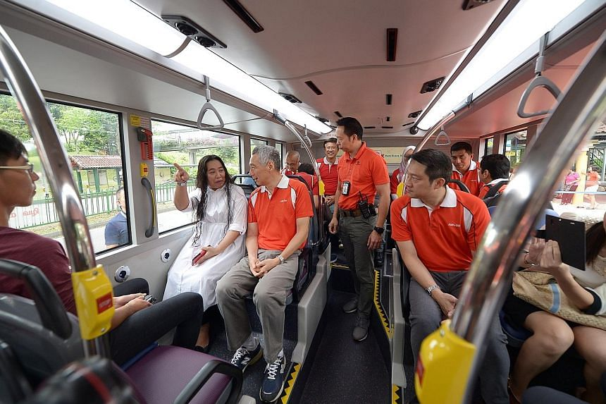 Ang Mo Kio resident Sumi Kamin (in white) chatting with Prime Minister Lee Hsien Loong aboard service 71 that was launched yesterday.