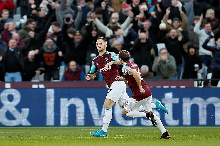 West Ham's Marko Arnautovic celebrating his goal with Mark Noble. It was the Austrian striker's first goal since his arrival from Stoke.