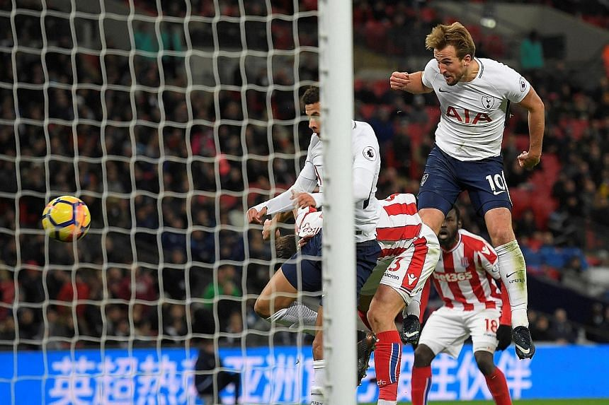 Harry Kane heads home a cross from Ben Davies in the 54th minute to put Tottenham 3-0 up against Stoke City yesterday at Wembley. The England striker added another in the second half for his brace. A first-half own goal from Ryan Shawcross - who also