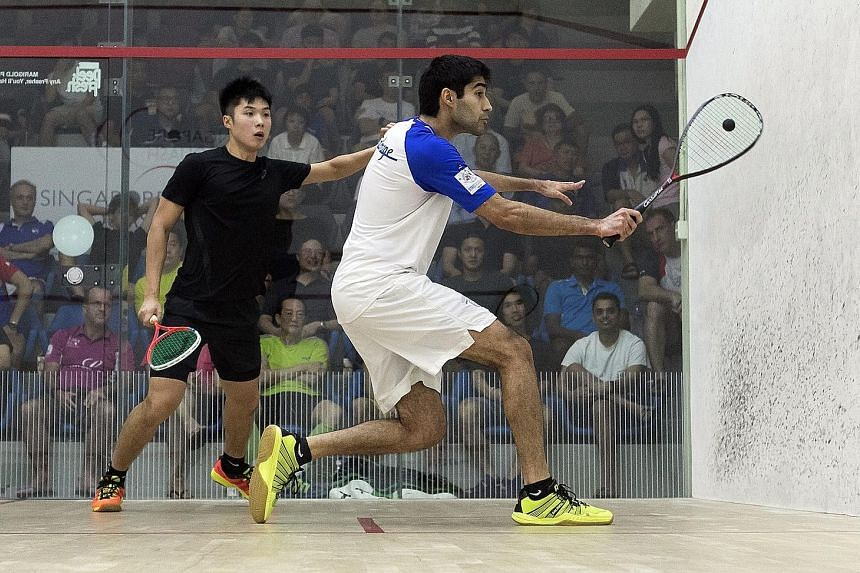 India's Ramit Tandon (right) upset top seed Henry Leung of Hong Kong 11-3, 11-6, 11-5 yesterday in the semi-finals of the Professional Squash Association Men's Challenger 5 event at the Singapore Squash Open. The sixth seed faces Chinese Taipei's Jam
