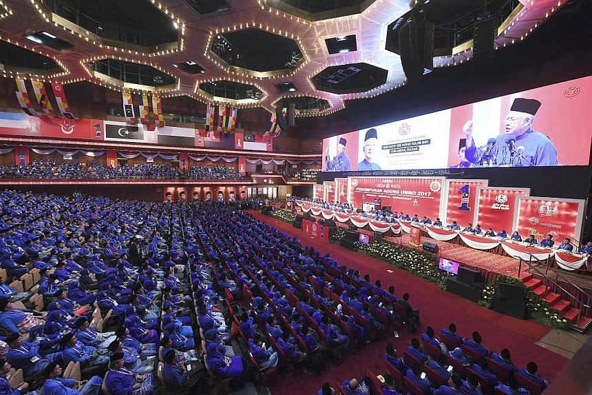 Prime Minister Najib Razak delivering his closing speech to Umno delegates at the end of the five-day general assembly yesterday. A resolution was passed last Friday ensuring Datuk Seri Najib and Deputy Premier Ahmad Zahid Hamidi would be unopposed a