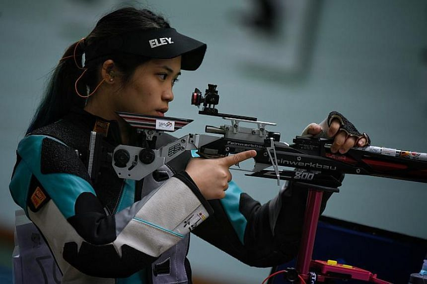 Singapore shooter Martina Lindsay Veloso in action during the SEA Games women's 10m air rifle.