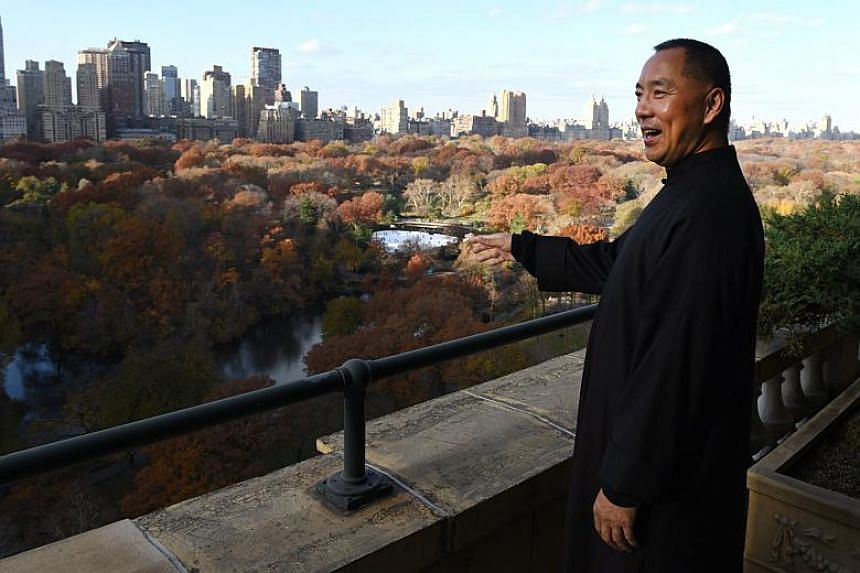 Billionaire Guo Wengui, who is seeking asylum in the United States after accusing officials in his native China of corruption, poses at his New York City apartment on Nov 28, 2017.
