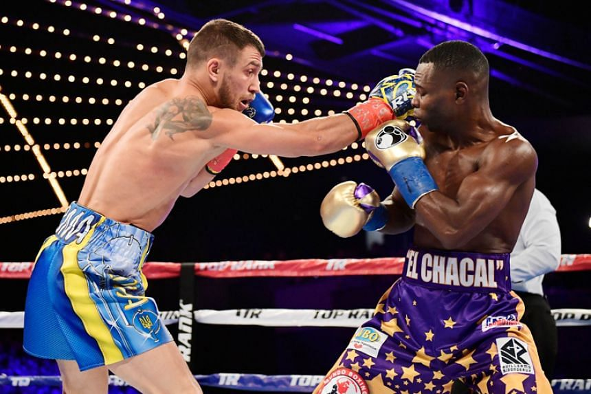 Vasyl Lomachenko punches Guillermo Rigondeaux during their Junior Lightweight bout at Madison Square Garden in New York on Dec 9, 2017.