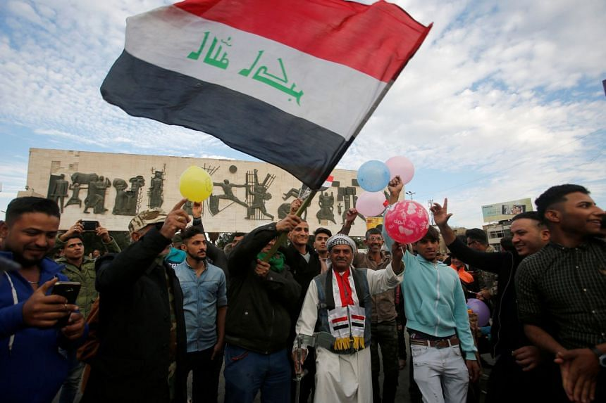 Iraqis celebrating the victory over ISIS, at Tahrir Square in Baghdad on Dec 10, 2017.