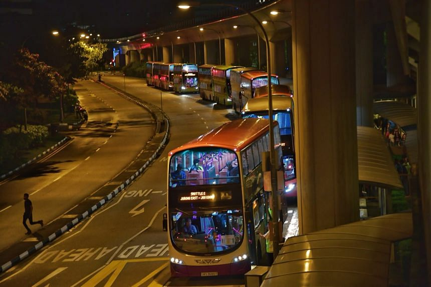 Shuttle buses waiting to pick up passengers at Jurong East at 10.50pm on Dec 10, 2017.