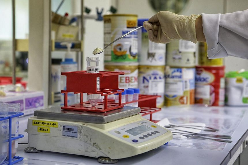 A sample of milk powder being prepared for food safety tests in the Agri-Food and Veterinary Authority's drug residues lab as part of its food safety surveillance programme.