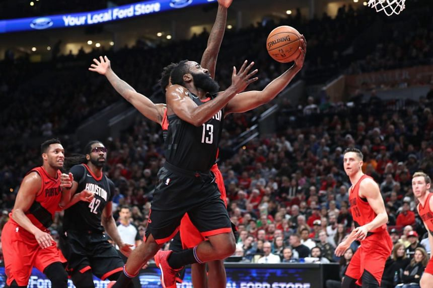 Houston Rockets guard James Harden (#13) attempting a layup against the Portland Trail Blazers during their NBA match in Portland on Dec 9, 2017.