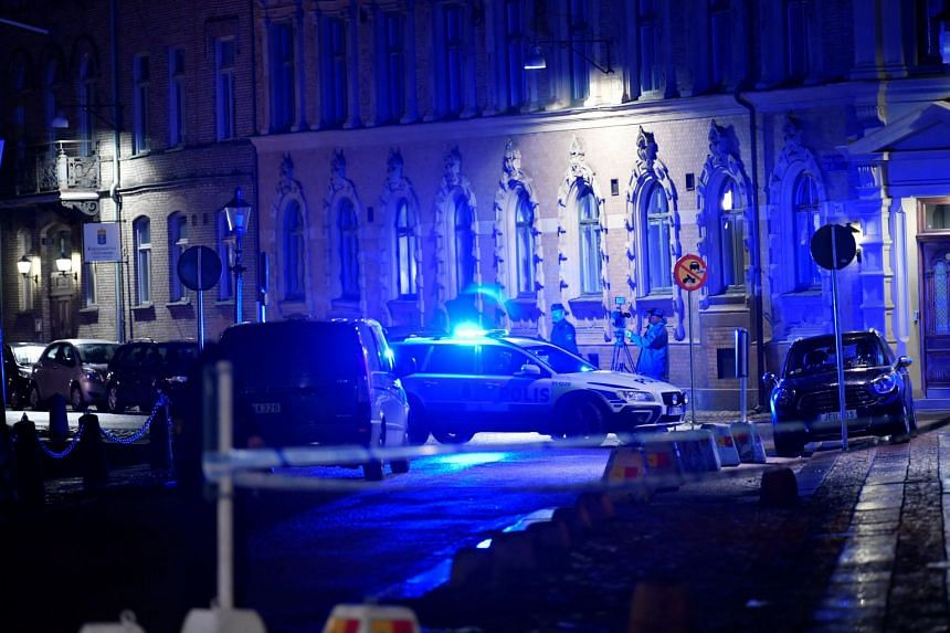 Police vehicles parked at the site of an attack near a synagogue in Gothenburg, Sweden, on Dec 9, 2017.