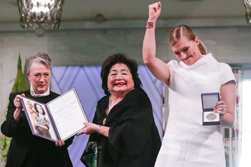 Beatrice Fihn (right), executive director of the International Campaign to Abolish Nuclear Weapons, receives the Nobel Peace Prize in Oslo on Dec 10, 2017.