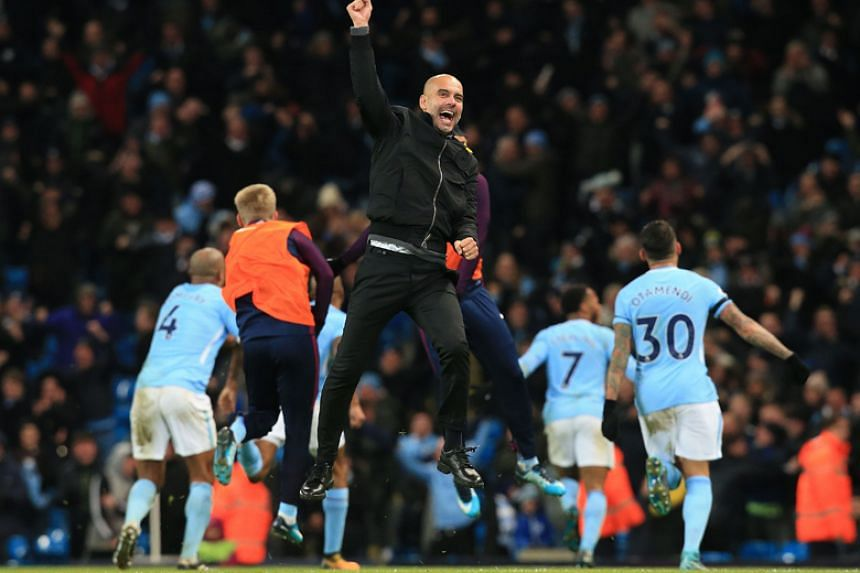 Manchester City manager Pep Guardiola celebrates after his team scored a second goal during the English Premier League football match against Southampton at the Etihad Stadium in Manchester on Nov 29, 2017.