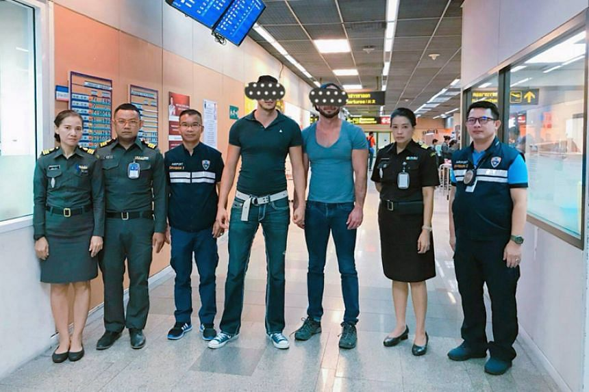 US citizens Joseph Dasilva and Travis Dasilva with Thai immigration police officers after they were arrested at Don Mueang International Airport in Bangkok on Nov 28, 2017.