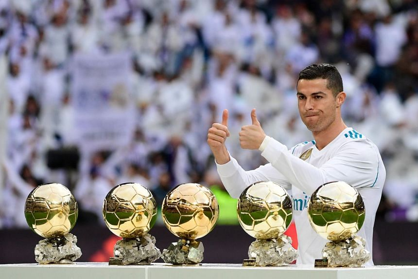 Ronaldo poses with his five Ballon d'Or trophies ahead of the match.