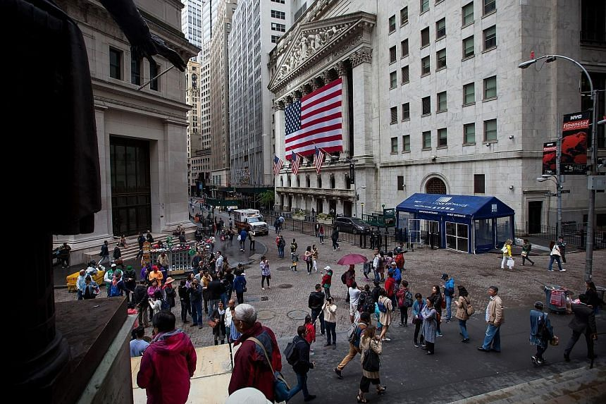 Wall Street in New York. The Dow Jones Industrial Average is up by almost 25 per cent for this year, and the rally is almost certain to continue this week, said Bank of America Merrill Lynch Global Research in a note.