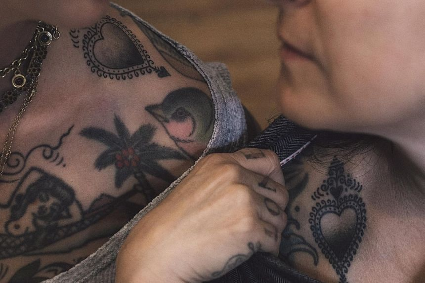 Ms Virginia Elwood and Ms Stephanie Tamez have matching tattoos made with ink that contains each other's DNA, a sample of which was synthesised into Everence, a powdery substance (above).