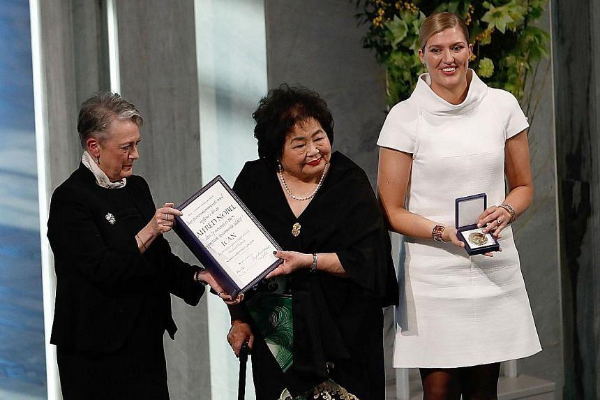 (From left) Norwegian Nobel Committee chairman Berit Reiss-Andersen presenting the peace prize to Hiroshima bombing survivor Setsuko Thurlow and Ican head Beatrice Fihn in Oslo yesterday.