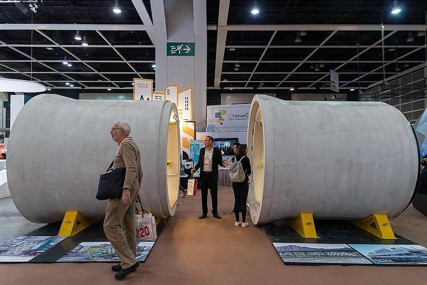 A man's home is his castle, be it a mansion or, in this case, OPod. Mr Jonathan Kong (above), a designer director at James Law Cybertecture, shows how anyone may be ruler of his own space inside the OPod Tube House, which was displayed at the DesignI