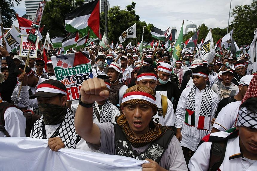 Protesters at a rally outside the US Embassy in Jakarta yesterday. They were among thousands who have protested in Asian cities against the controversial US decision to recognise Jerusalem as the capital of Israel.