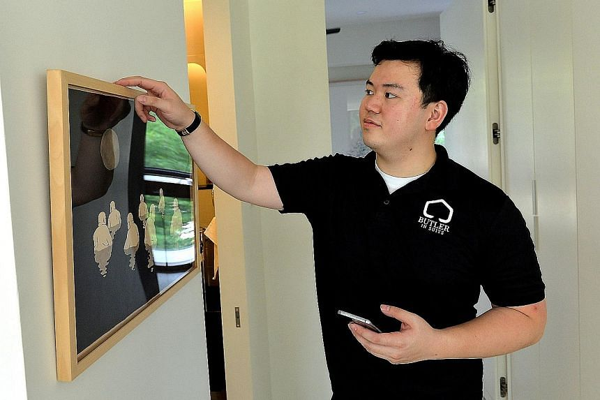 Butler In Suits founder Poon Da Qian doing a cleanliness check. The firm has over 200 clients, of whom15 per cent are local.