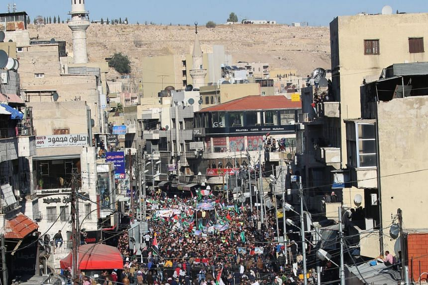 People march during an anti-Trump, anti-Israel protest in Amman on Dec 8, 2017.