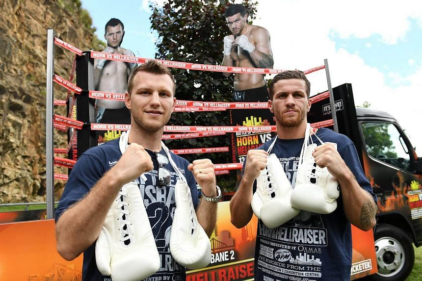 Australian boxer and WBO world welterweight champion Jeff Horn and British boxer Gary Corcoran (right) pose for a photograph during a media event in Brisbane, on Dec 5, 2017.