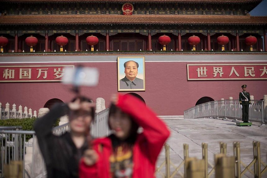 A Chinese paramilitary policeman stands guard outside the Forbidden City near Tiananmen Square during the Communist Party's 19th Congress in Beijing on Oct 23.