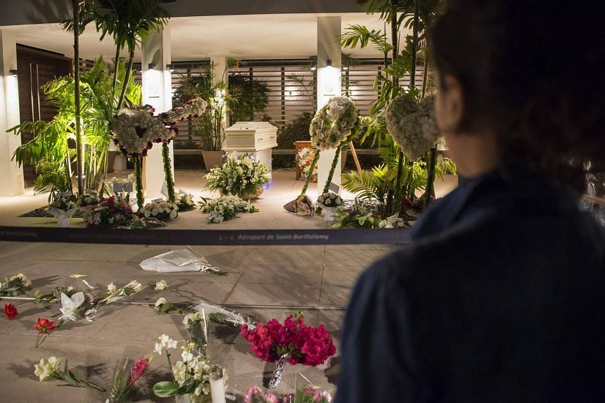 The residents of Saint-Barthélemy pay a last tribute to French music icon Johnny Hallyday before his burial during the public wake at the Saint John Funeral Home on Dec 10, 2017.
