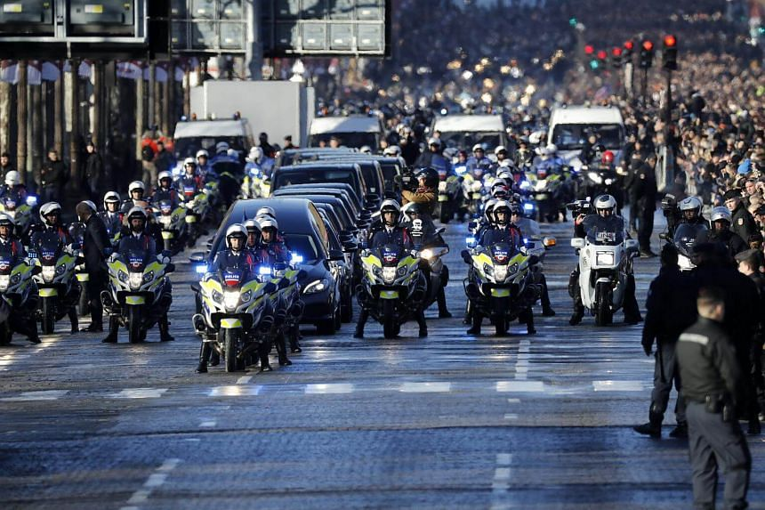 The funeral cortege with the coffin of late French rocker Johnny Hallyday drives down the Champs Elysees avenue to the Concorde Square ahead of the tribute ceremony in Paris, France, on Dec 9, 2017.