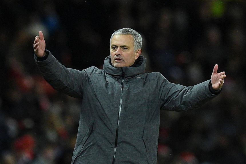 Manchester United manager Jose Mourinho had a verbal altercation before having water and milk thrown at him by City's players and being hit on the head with a plastic bottle, reports said.