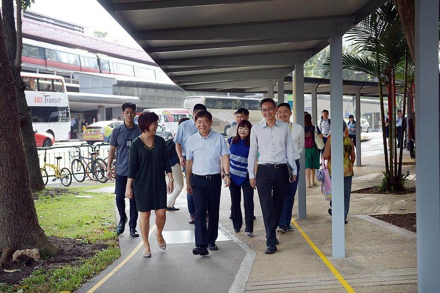 (From left) Chief executive of SG Enable Ku Geok Boon, Transport Minister Khaw Boon Wan, LTA group director corporate communications Helen Lim, and LTA group director of technology and industry development Lam Wee Shann at the route between Redhill M