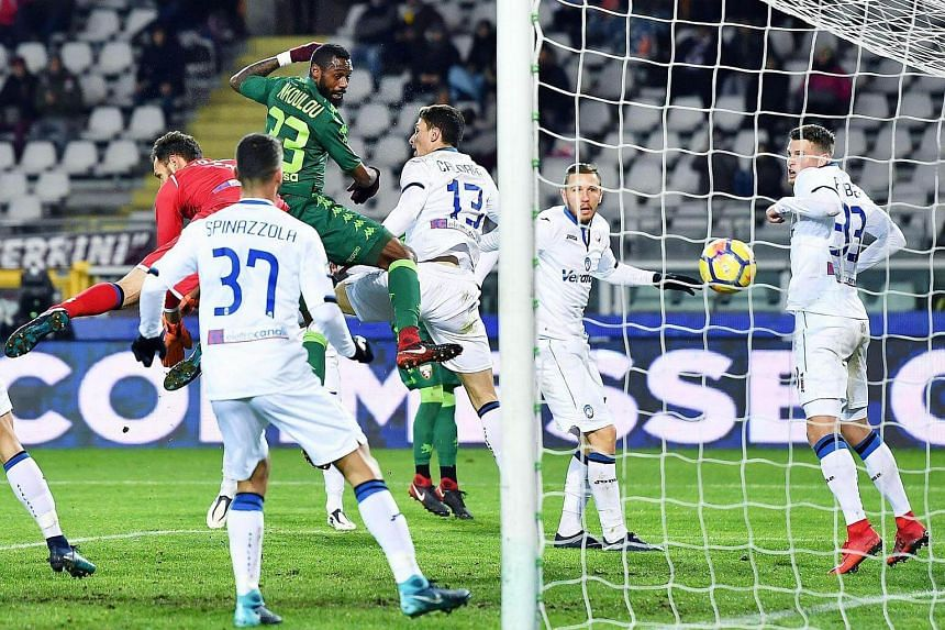 Torino's Nicolas N'Koulou (centre) scores the opening goal during the Italian Serie A match between Torino FC and Atalanta BC at Olimpico stadium in Turin, on Dec 2, 2017.