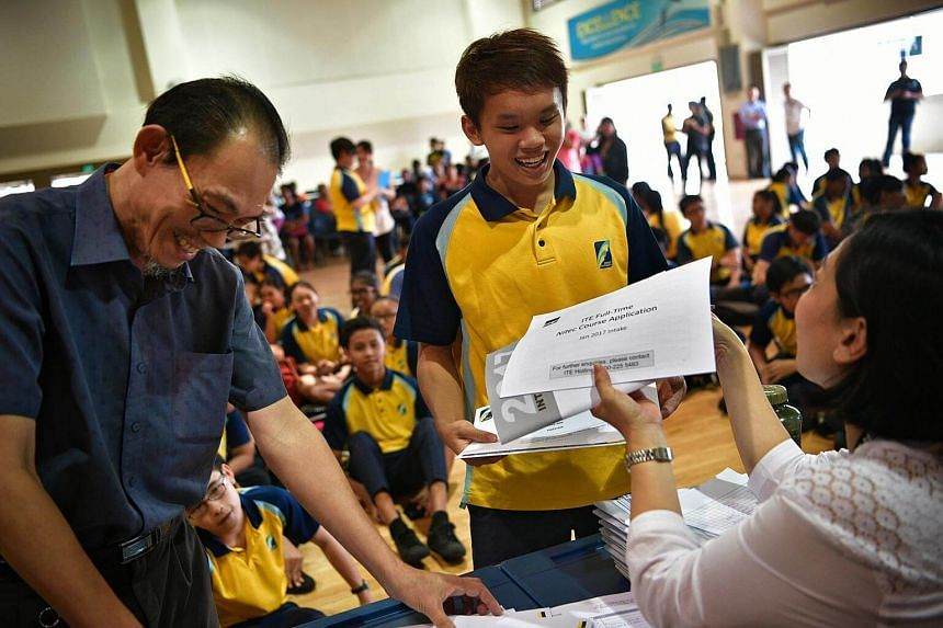 Crest Secondary student Ryan Ang collecting his N-level results on Dec 19, 2016.