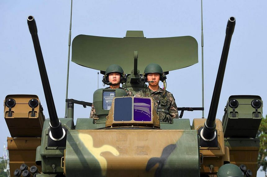 South Korean soldiers sitting on a K30 Biho twin 30 mm self-propelled anti-aircraft weapon during a media day presentation of a commemoration event marking South Korea's Armed Forces Day.