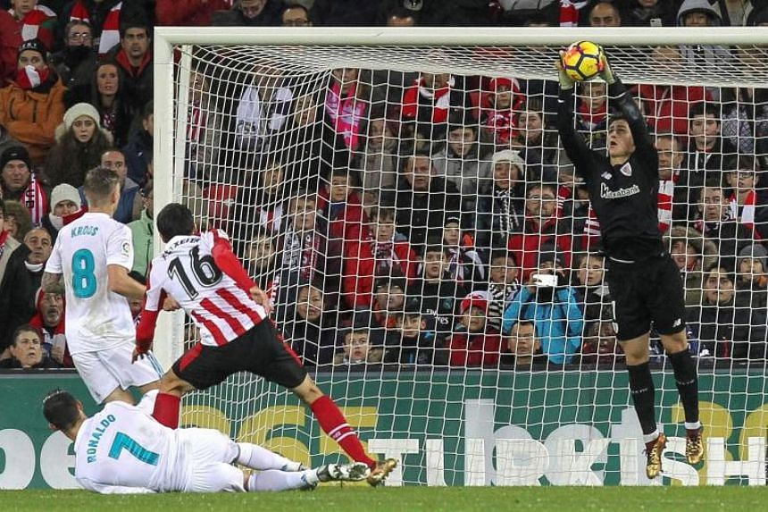 Athletic Bilbao's goalkeeper Kepa Arrizabalaga (right) catches a ball thrown during a match of La Liga Santander in Bilbao, Spain on Dec 2, 2017.