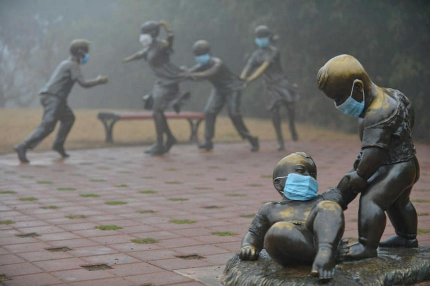 Statues are seen with masks in a park in Puyang, Henan province, on a hazy day on Jan 4, 2017. Puyang was one of eight cities that failed to meet air quality targets in October and November.