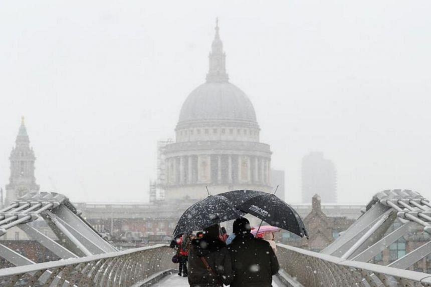 The Millennium Bridge with St Paul's Cathedral in the background in central London on Dec 10, 2017.