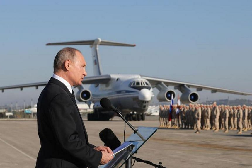 Russian President Vladimir Putin visits the Russian air base in Hmeimim, in the northwestern Syrian province of Latakia, on Dec 11, 2017.