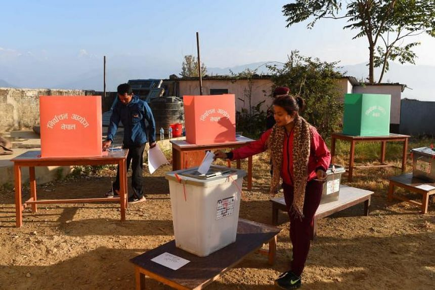 A Nepali woman casts her vote at a polling station during the general election at Chautara, Sindhupalchowk district some of 100 kilometers east of Kathamndu on Nov 26, 2017.