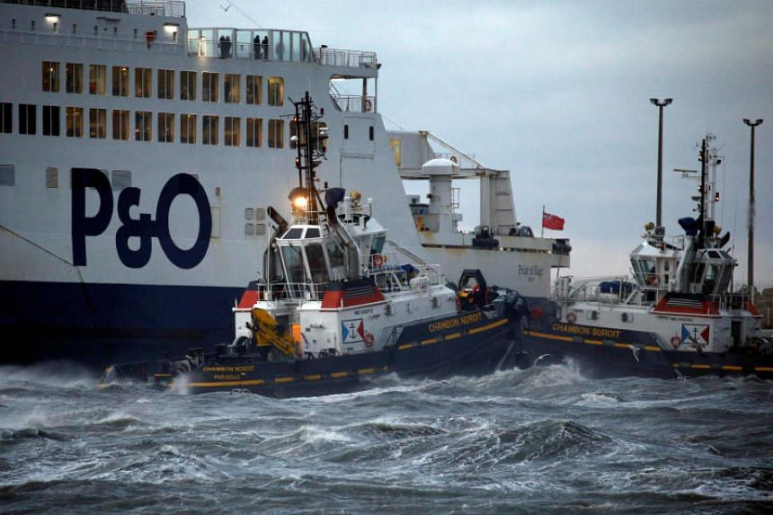 Tugboats manoeuvre the P&O ferry Pride of Kent after it ran aground during bad weather in the port of Calais in northern France, on Dec 10, 2017.