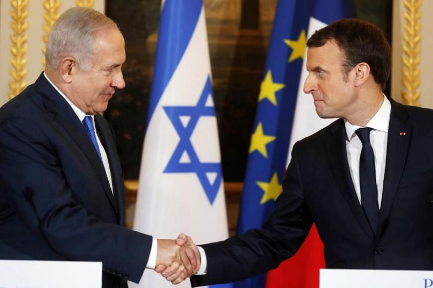 French President Emmanuel Macron (right) and Israeli Prime Minister Benjamin Netanyahu hold a joint press conference at the Elysee Palace in Paris, France, on Dec 10, 2017.