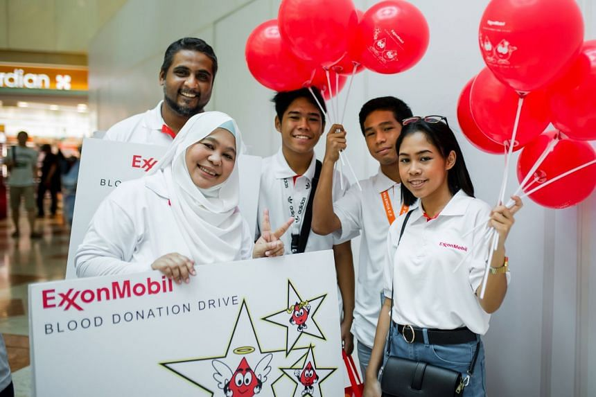Ms Khairiah Onan (left) and her family at this year's Blood Drive at West Mall. PHOTO: EXXONMOBIL